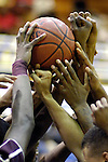 A&M players raise hands and ball before game.  A&M vs. Tuskegee men's basketball at Alabama A&M. Bob Gathany / The Huntsville Times