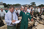 Priddy Sheep Fair auctioneer and assistant Somerset Uk 2009 . Making a sale taking a bid.