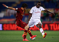 Calcio, Serie A: Roma vs Milan. Roma, stadio Olimpico, 25 aprile 2014.<br /> AS Roma defender Dodo', of Brazil, left, and AC Milan forward Mario Balotelli fight for the ball during the Italian Serie A football match between AS Roma and AC Milan at Rome's Olympic stadium, 25 April 2014.<br /> UPDATE IMAGES PRESS/Isabella Bonotto
