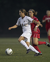 Boston College forward Stephanie McCaffrey (9) dribbles. After 2 complete overtime periods, Boston College tied Boston University, 1-1, after 2 overtime periods at Newton Soccer Field, August 19, 2011.