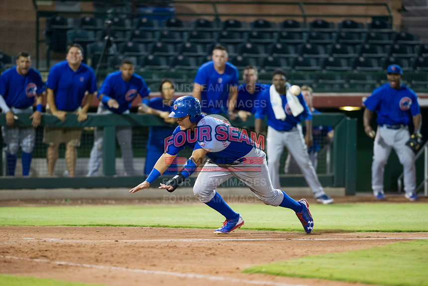 AZL Cubs first baseman Luis Hidalgo (18) slides head first into home plate against the AZL Giants on September 5, 2017 at Scottsdale Stadium in Scottsdale, Arizona. AZL Cubs defeated the AZL Giants 10-4 to take a 1-0 lead in the Arizona League Championship Series. (Zachary Lucy/Four Seam Images)