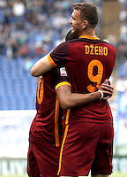 Calcio, Serie A: Lazio vs Roma. Roma, stadio Olimpico, 3 aprile 2016.<br /> Roma's Edin Dzeko, right, celebrates with teammate Seydou Keita after scoring during the Italian Serie A football match between Lazio and Roma at Rome's Olympic stadium, 3 April 2016.<br /> UPDATE IMAGES PRESS/Isabella Bonotto
