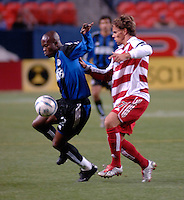 Colorado midfielder Alain Nkong shields the ball from FC Dallas midfielder Simo Valakari. The Colorado Rapids drew 0-0 with FC Dallas in the first game of the Western Conference Semi-finals Invesco Field at Mile High, Denver, Colorado, September 22, 2005.