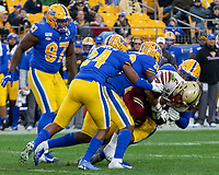 The Pitt defense led by linebackers Phil Campbell (24) and Kylan Johnson (28) gang tackle Boston College running back AJ Dillon. The Boston College Eagles defeated the Pitt Panthers 26-19 in the football game played at Heinz Field, Pittsburgh Pennsylvania on November 30, 2019.