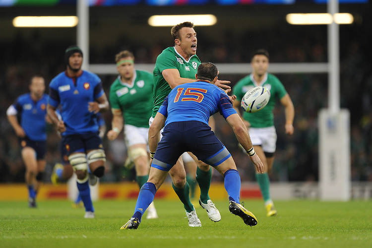 Tommy Bowe of Ireland passes just before he is tackled by Scott Spedding of France during Match 39 of the Rugby World Cup 2015 between France and Ireland - 11/10/2015 - Millennium Stadium, Cardiff<br /> Mandatory Credit: Rob Munro/Stewart Communications