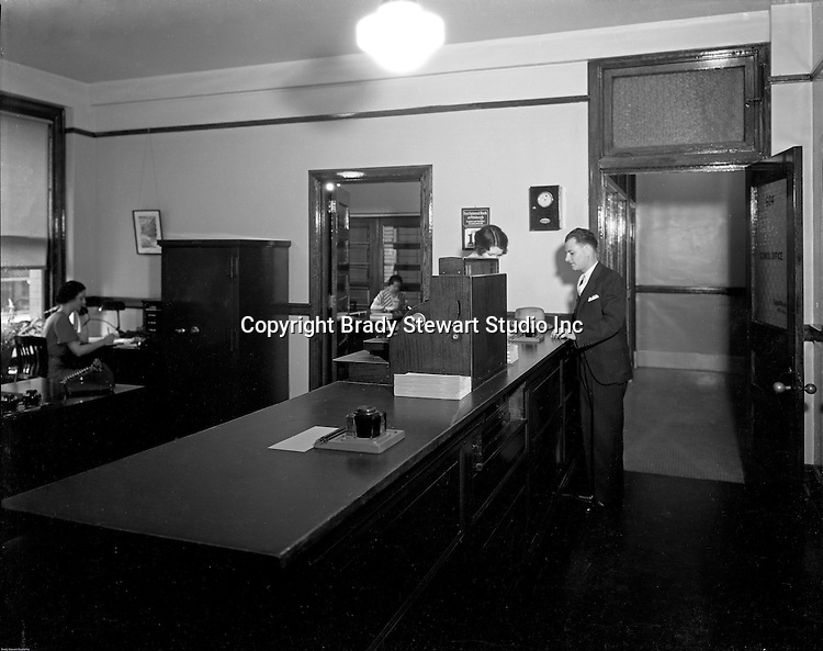 Pittsburgh PA:  Employees at work, Office of the Registrar, Duquesne University.<br />