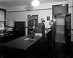 Pittsburgh PA:  Employees at work, Office of the Registrar, Duquesne University.<br /> Brady Stewart was hired to photography the campus, classrooms, and offices for a publication to increase enrollment at the Catholic University.