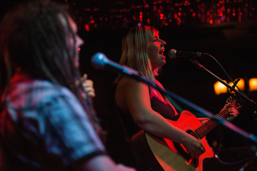 """Emma Hill and her musical partner of eight years, Bryan Daste, perform during the release party for Emma's """"Ten Years"""" album at Taproot."""