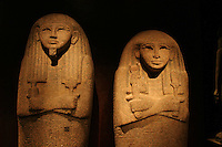 ITALIA - Torino - Museo Egizio  Coperchi di sarcofagi in granito rosa..A sinistra ritrae Thutmosi funzionario del tempio di Amon, stringe tra le mani i simboli ded (destra) e tit (sinistra) sacri a Osiride e Iside..  A destra il coperchio del sarcofago di Isi moglie di Thutmosi, stringe con l amano destra un sistro, sacro a Hathor. Gli occhi erano realizzati con materiali ddiversi di cui rimangono tracce di pigmento..XIX dinastia regno di Ramesse II, da el Khocha tomba n.32