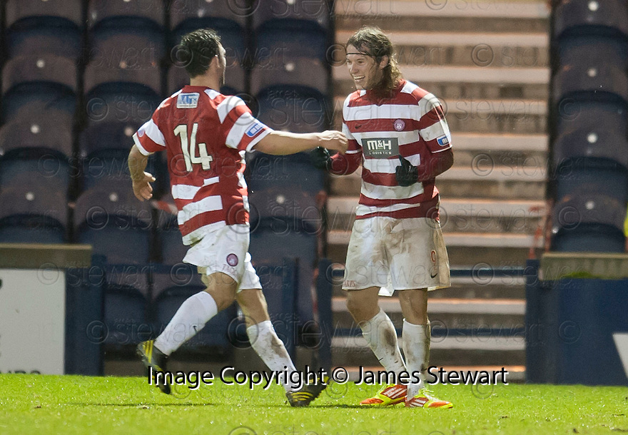 Accies Stevie May is congratulated by Gary Fraser after he scores their second goal.