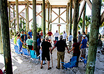 CRAWFORDVILLE, FL - OCTOBER 14: Pastor Gary Pritchett leads the prayer during church service under the Seafarers Chapel at Shell Point after Hurricane Michael on October 14, 2018 in Crawfordville, Florida. (Photo by Mark Wallheiser/Getty Images)