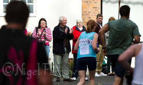09 SEP 2011 - CHESTER, GBR - Spectators cheer runners during the MBNA Chester Marathon (PHOTO (C) NIGEL FARROW)