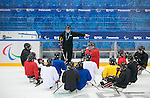 Sochi, RUSSIA - Mar 1 2014 -  Head Coach Mike Mondin gives instructions to the team during their first practice before the 2014 Paralympics in Sochi, Russia.  (Photo: Matthew Murnaghan/Canadian Paralympic Committee)