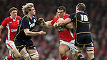 Richie Gray and John Barclay close the gap on Jamie Roberts..RBS 6 Nations 2012.Wales v Scotland.Millennium Stadium.12.02.12.Credit: Steve Pope - Sportingwales
