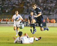 Bobby Convey jumps over a Guatemalan player during a 0-0 tie at Estadio Mateo Flores in Guatemala City, Guatemala, Wednesday, Sept. 7, 2005.