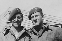 BNPS.co.uk (01202) 558833. <br /> Pic: Bosleys/BNPS<br /> <br /> Pictured: Two of Sergeant Samuel Rushworth's comrades poses for a photograph. <br /> <br /> Never before seen photos taken by a fishmonger turned SAS hero behind enemy lines in World War Two have come to light 76 years on.<br /> <br /> Sergeant Samuel Rushworth, of the 2nd Special Air Service, was dropped into occupied France two days before D-Day in June 1944.<br /> <br /> They were tasked with disrupting German reinforcements dispatched to Normandy following the Allied landings.
