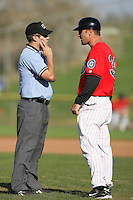 April 18, 2010: Jim Horner, manager of the High Desert Mavericks, talks with umpire Charles Billington during game against the Lake Elsinore Storm at Mavericks Stadium in Adelanto,CA.  Photo by Larry Goren/Four Seam Images