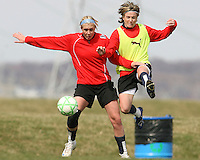 Rebecca Moros tangles with Sonia Bompastor during Washington Freedom  practice and media event at the Maryland Soccerplex on March 25 in Boyd's, Maryland.