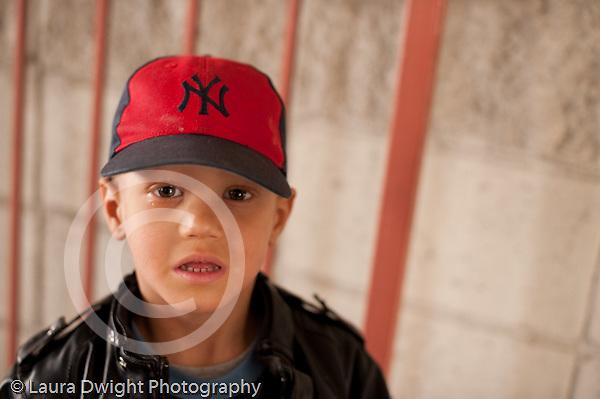 Preschool  3-5 year old portrait of boy wearing red baseball cap outside horizontal