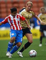 Evelyn Armoa (PAR) and Courtney Verloo (USA)..FIFA U17 Women's World Cup, Paraguay v USA, Waikato Stadium, Hamilton, New Zealand, Sunday 2 November 2008. Photo: Renee McKay/PHOTOSPORT