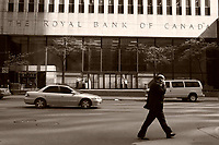 A businessman talk on his blackberry while walking<br />  in front of the Royal Bank of Canada building on King Street West in downtown Toronto, May 24, 2007<br /> <br />     photo by Pierre Roussel - Images Distribution