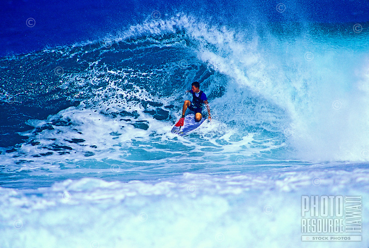 Surfing a beautiful large wave on Maui's northwest coast.