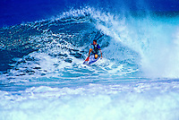 Surfing a beautiful large wave on Maui's northwest coast.