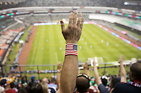 MEXICO CITY, MEXICO - June 11, 2017:  USA fans cheer during the World Cup Qualifier match against Mexico at Azteca Stadium.
