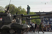 Moscow, Russia, 09/05/2010..A statue of poet Alexander Pushkin gazes down on Russian military vehicles and weaponry on their way through central Moscow to Red Square for the Victory Day parade, the largest ever.