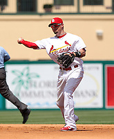 St Louis Cardinals second baseman Tyler Greene #27 throws to first during a spring training game against the Detroit Tigers at Roger Dean Stadium on March 28, 2012 in Jupiter, Florida.  Cardinals defeated the Tigers 9-5.  (Mike Janes/Four Seam Images)