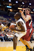 Eric Boateng of Arizona State controls the ball ahead of a bleeding Andrew Zimmermann of Stanford. The Stanford Cardinal, ranked 7th in the Pac-10 defeated the 2nd ranked Arizona State Sun Devils 70-61 during the Pac-10 Tournament at the Staples Center in Los Angeles, California on March 11th, 2010.