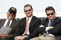 Dave Aros, (PLHS Coach) Mike Hastings (Head Coach PLHS) and Steve Cota (coach) share a light-hearted moment during a Memorial service held for Coach Bennie Eden at the Point Loma High School Football stadium that was recently renamed in his honor, Saturday February 23 2008.