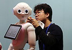 July 21, 2016, Tokyo, Japan - Japanese communication giant Softbank's humanoid robot Pepper gets a maintenance from a robot creator Wataru Yoshizaki of Asratec at Softbank's two-day convention Softbank World in Tokyo on Thursday, July 21, 2016. Softbank CEO Masayoshi Son delivered a keynote speech at the event after the company announced to acquire British chip maker ARM last week.     (Photo by Yoshio Tsunoda/AFLO) LWX -ytd-