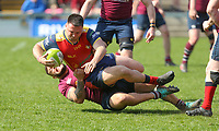 Monday 22nd April 2019 | 2019 Ulster Towns Cup Final<br /> <br /> Owen Kirk is tackled by Tyler Millar during the Ulster Towns Cup final between Enniskillen and Ballyclare at Kingspan Stadium, Ravenhill Park, Belfast. Northern Ireland. Photo John Dickson/Dicksondigital