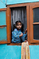 Girl in window. Srinagar, Kashmir,India. © Fredrik Naumann/Felix Features