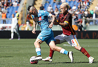 Calcio, Serie A: Roma vs Napoli. Roma, stadio Olimpico, 25 aprile 2016.<br /> Napoli's Marek Hamsik, left, is challenged by Roma's Radja Nainggolan during the Italian Serie A football match between Roma and Napoli at Rome's Olympic stadium, 25 April 2016. <br /> UPDATE IMAGES PRESS/Isabella Bonotto