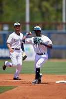 Charlotte Stone Crabs second baseman Vidal Brujan (2) throws to first base as shortstop Tyler Frank looks on during a Florida State League game against the Dunedin Blue Jays on April 17, 2019 at Charlotte Sports Park in Port Charlotte, Florida.  Charlotte defeated Dunedin 4-3.  (Mike Janes/Four Seam Images)