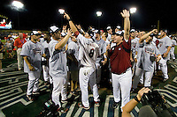 The South Carolina coach Ray Tanner talks to the crowd as his Gamecocks celebrate winning the NCAA Division One Men's College World Series on June 29th, 2010 at Johnny Rosenblatt Stadium in Omaha, Nebraska.  (Photo by Andrew Woolley / Four Seam Images)