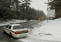 OKA, QUEBEC, JANUARY 19, 2010---An SQ patrol car turns onto highway 344  at the Mohawk community of Kahnesatake, just outside Oka, after the Mohawk erected signs yesterday instructing a developer not to build houses on disputed land across the street from their ancestral burial ground, which was the flashpoint of the 1990 Oka crisis. The Kanesatake band council referred to events during the 1990 Oka crisis when it sent a letter last month to Norfolk's owner, Normand Ducharme, demanding he not develop the land.<br />  (GAZETTE PHOTO/Robert J. Galbraith)