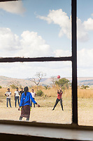 View of girls playing at local village school with ball on schoolyard, in Lubombo Region, Eswatini