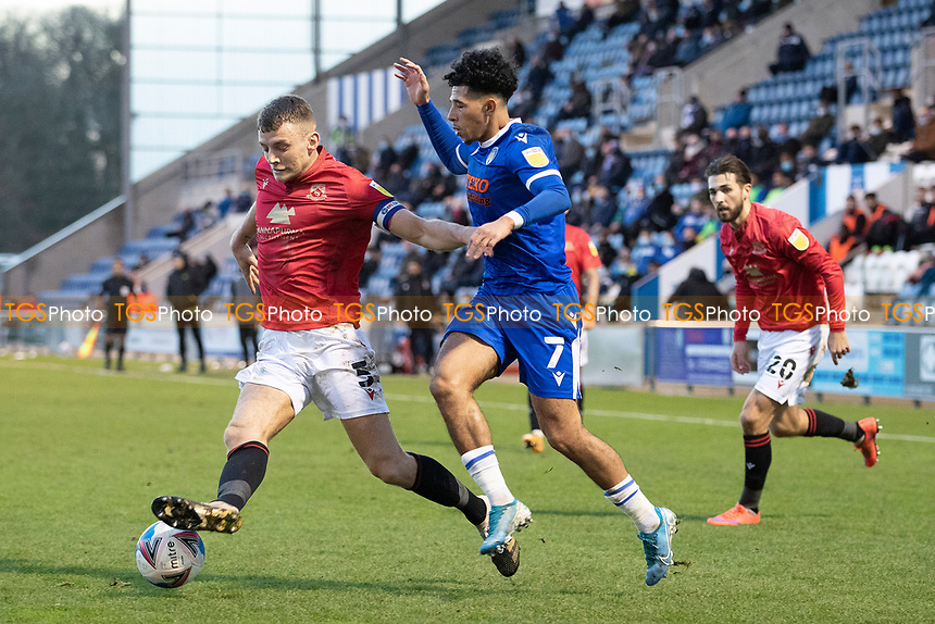 Sam Lavelle of Morecambe  gets the better of Courtney Senior, Colchester United during Colchester United vs Morecambe, Sky Bet EFL League 2 Football at the JobServe Community Stadium on 19th December 2020