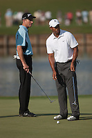 PONTE VEDRA BEACH, FL - MAY 6: Jim Furyk and Tiger Woods discuss the slope of the 16th green during the practice round on Wednesday, May 6, 2009 for the Players Championship, beginning on Thursday, at TPC Sawgrass in Ponte Vedra Beach, Florida.