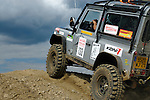 Land Rover Defender 90, racing at the Rallye Dresden Breslau 2007, approaching the top of a hill. --- No releases available. Automotive trademarks are the property of the trademark holder, authorization may be needed for some uses.