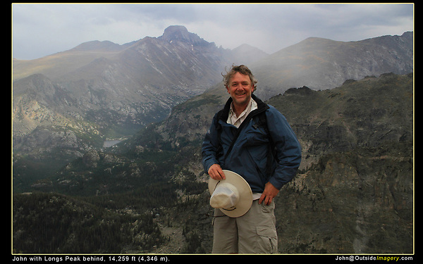 John descending Flattop Mountain with Longs Peak behind.  John was senior rock climbing and mountaineering instructor for the Colorado Mountain Club for 5 years. <br />