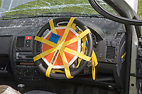 Air bag restraint covering steering wheel to prevent deployment whilst Firefighters work on car and release driver..©shoutpictures.com..john@shoutpictures.com
