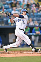 Asheville Tourists left fielder Sam Hilliard (25) swings at a pitch during a game against the Lexington Legends at McCormick Field on April 19, 2016 in Asheville, North Carolina. The Legends defeated the Tourists 11-9. (Tony Farlow/Four Seam Images)