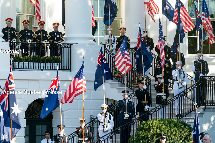 Military personnel holding flags line the South Portico stairway during the State Visit Friday, Sept. 20, 2019, on the South Lawn of the White House. (Official White House Photo by Andrea Hanks)
