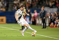 CARSON, CA - SEPTEMBER 21: Dave Romney #4 of the Los Angeles Galaxy turns with the ball during a game between Montreal Impact and Los Angeles Galaxy at Dignity Health Sports Park on September 21, 2019 in Carson, California.