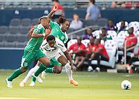 KANSAS CITY, KS - JUNE 26: Daniel Kadell #3 and Neil Danns #16 defend against Levi Garcia #11 during a game between Guyana and Trinidad