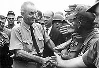President Lyndon B. Johnson greets American troops in Vietnam, 1966.<br /> <br /> Credit: National Archives and Records Administration